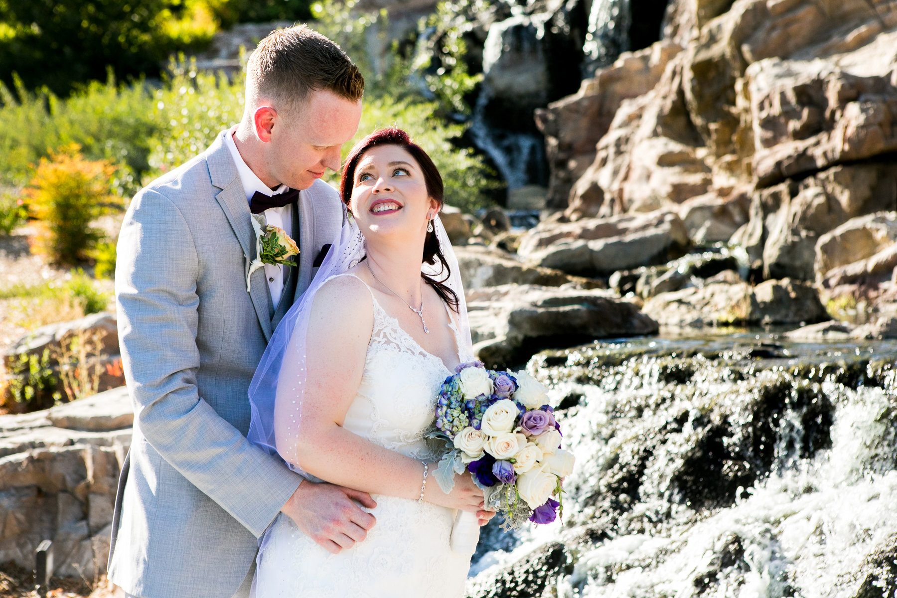 waterfall bride and groom portrait at dove canyone wedding photos