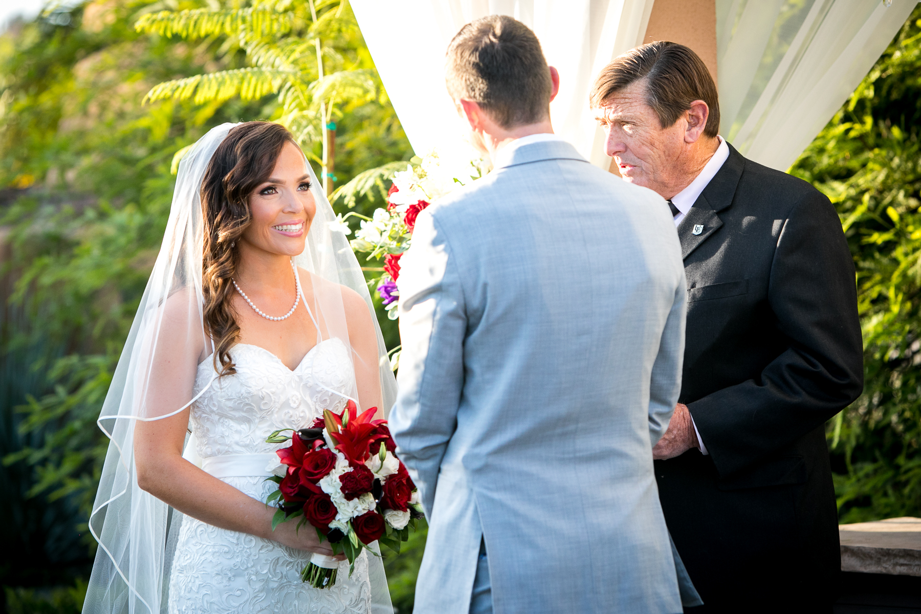 bride constantly smiling during wedding ceremony at wedgewood corona photos