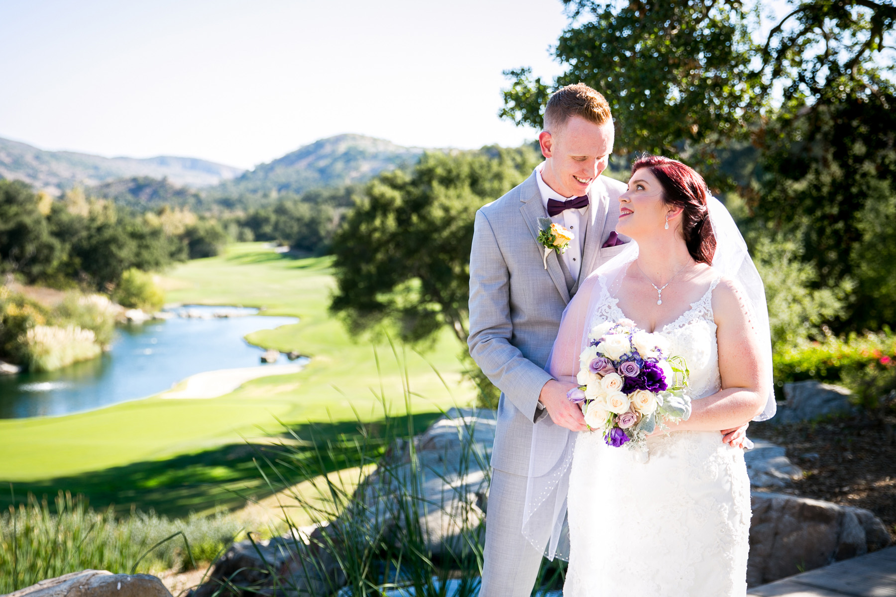 bride and groom with scenery down below at dove canyon golf course