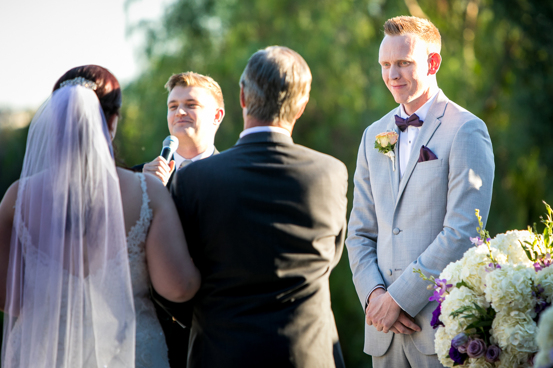 groom sees bride walking down the aisle with father at dove canyone wedding photos