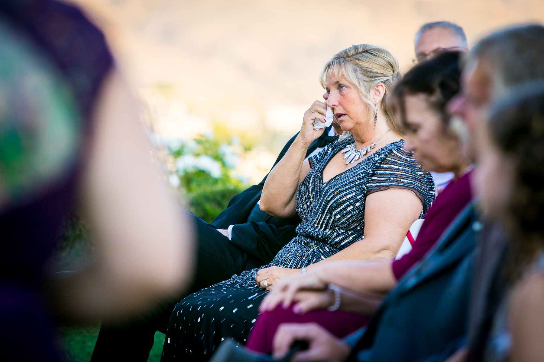 mother of groom cries during wedding vows at corona wedding photographer