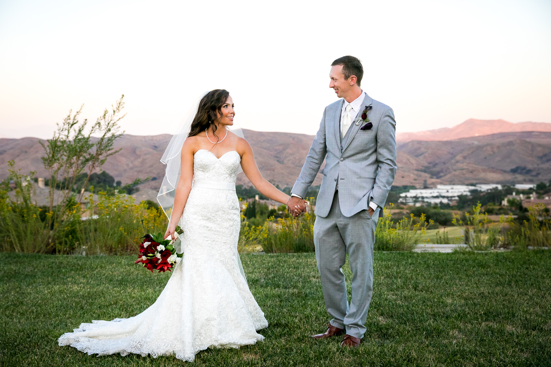 bride and groom hold hands scenic view at champion's club at the retreat wedding photos