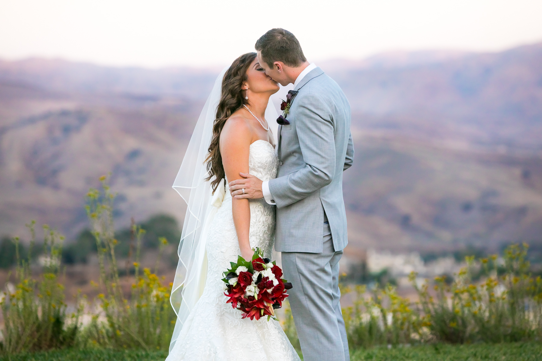 bride and groom kiss scenic mountains at wedding at wedgewood corona photographer