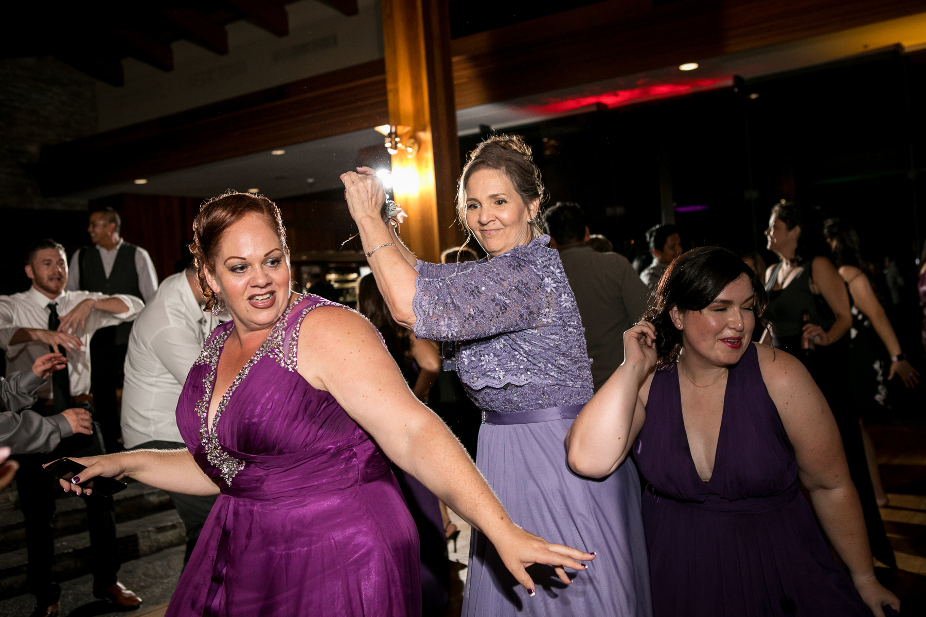bride's mom on dance floor during wedding reception at dove canyon golf club