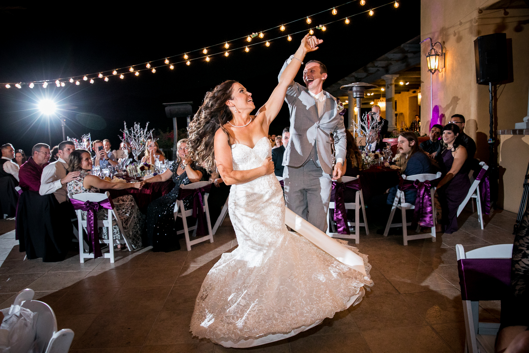 groom spins bride during first dance at wedding at the retreat photographer