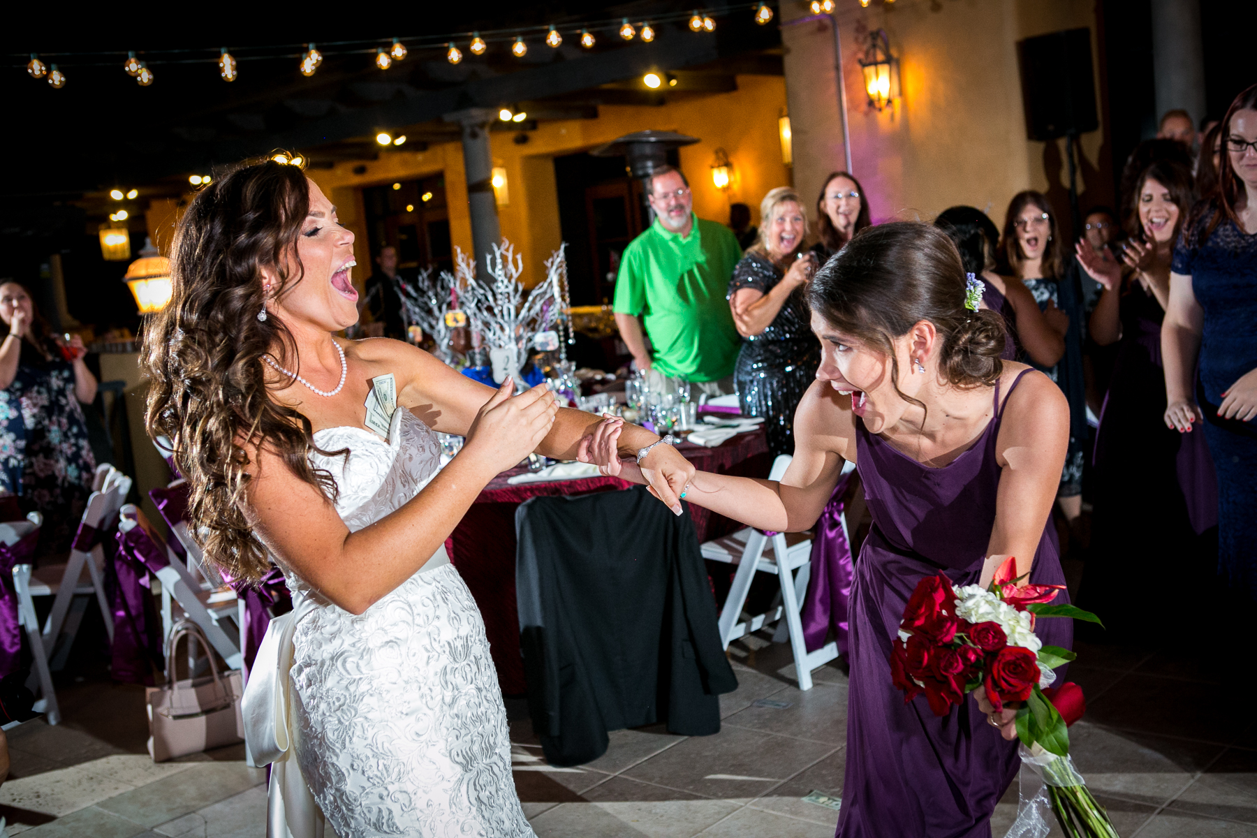 bride's sister catches the bouquet at wedding at chmpion's club at the retreat photos