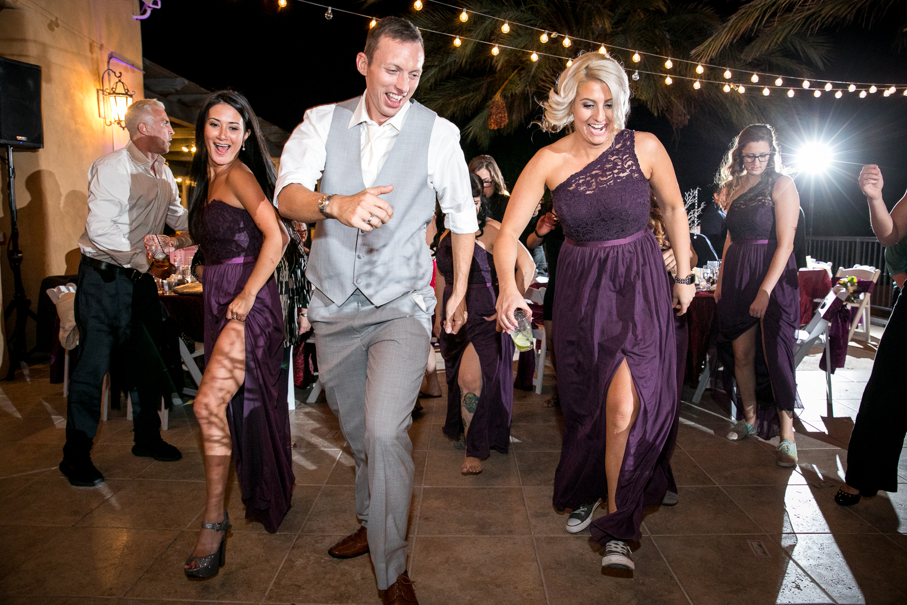 bridesmaids and groom dance at wedding at the retreat photographer