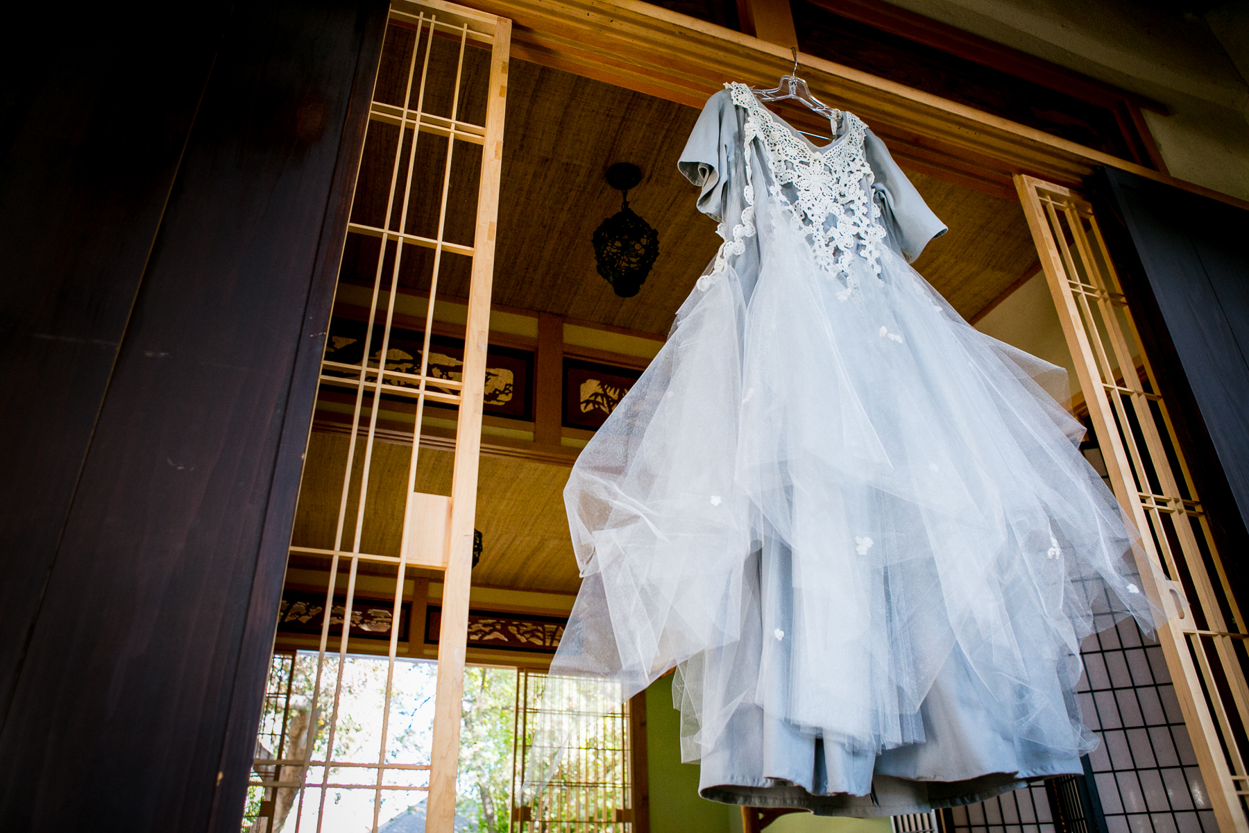 bride's hand crafted wedding dress hangs from storrier stearns teahouse wedding photos