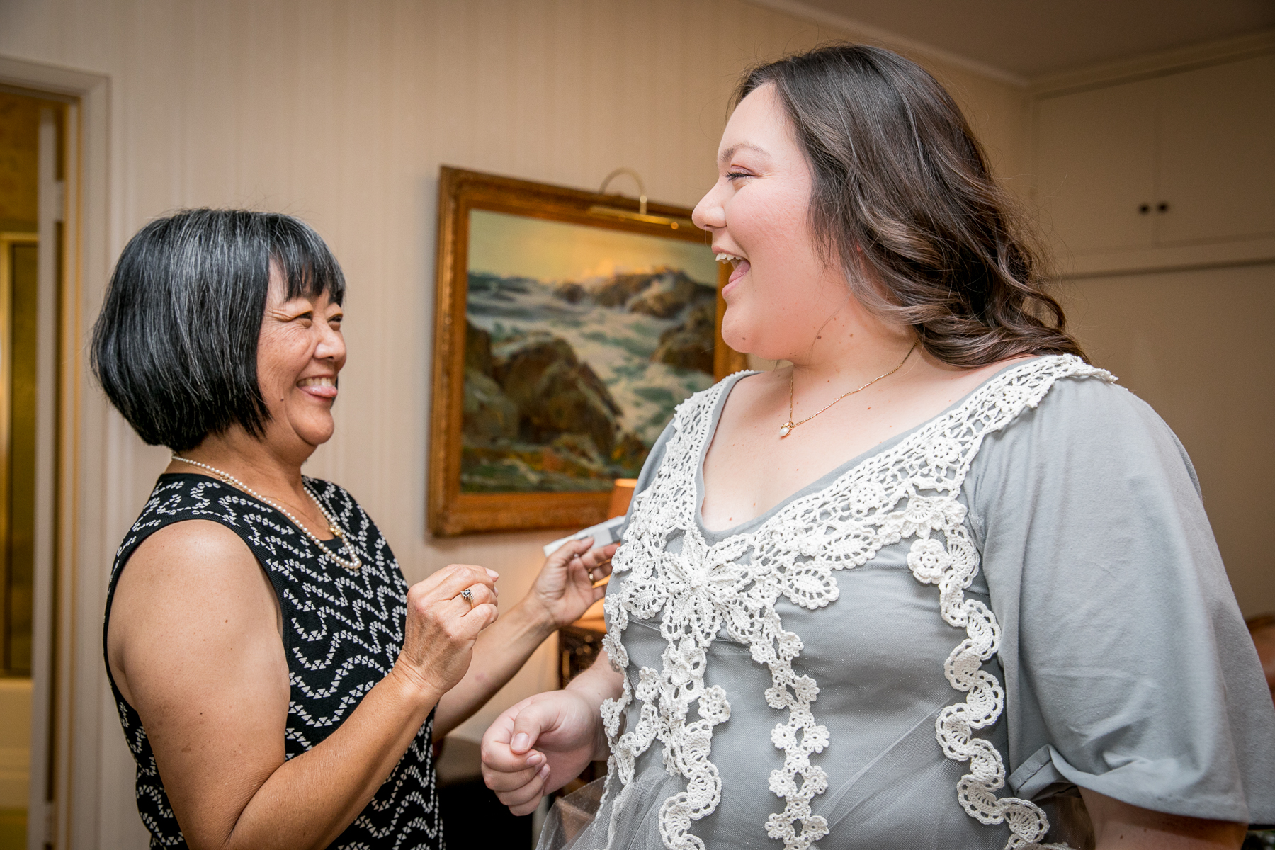 bride laughs with mother of bride while getting ready for wedding in pasadena photographer