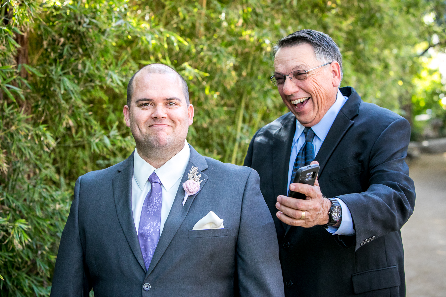 wedding guest jokes with Jonathan about football score during wedding in pasadena photography