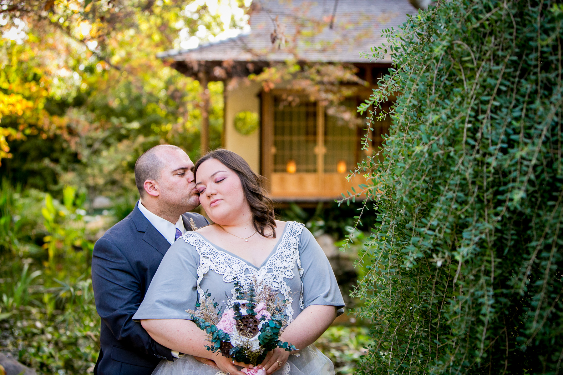 bride and groom intimate portrait with japanese tea house in background of pasadena wedding