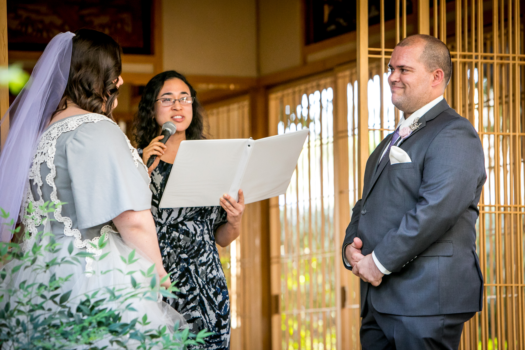 groom smiles during wedding ceremony at storrier stearns photographer