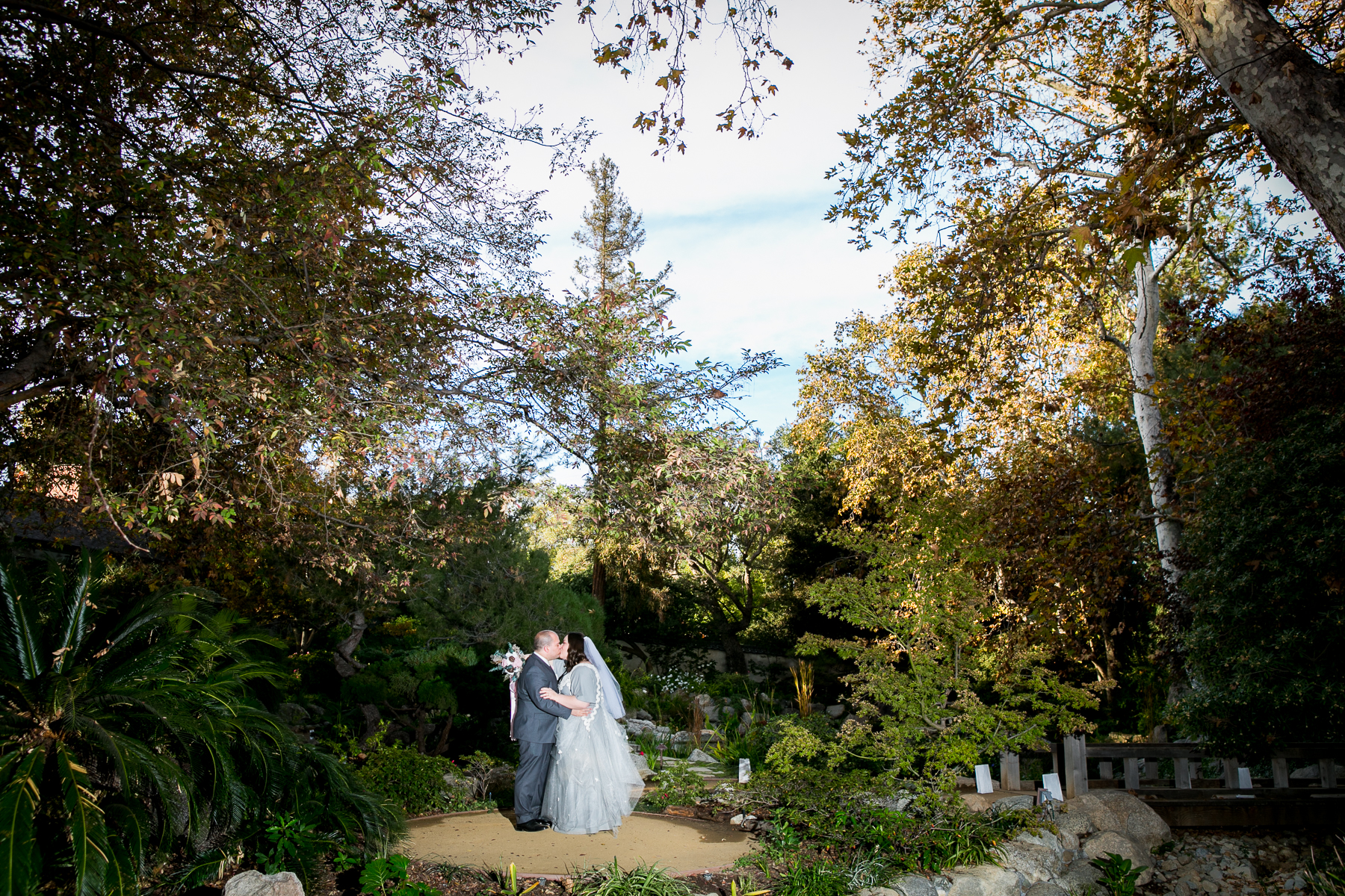 wide view portrait of bride and groom at storrier stearns japanese garden best photographer