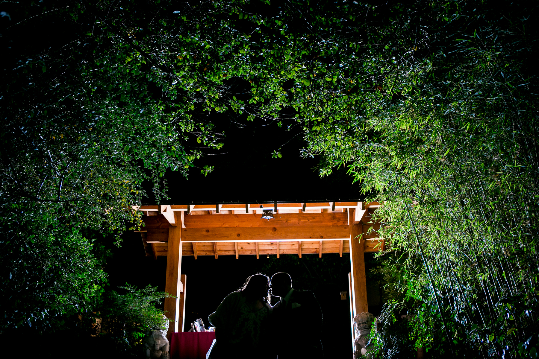 nighttime silhouette of bride and groom at storrier stearns japanese garden wedding photographer