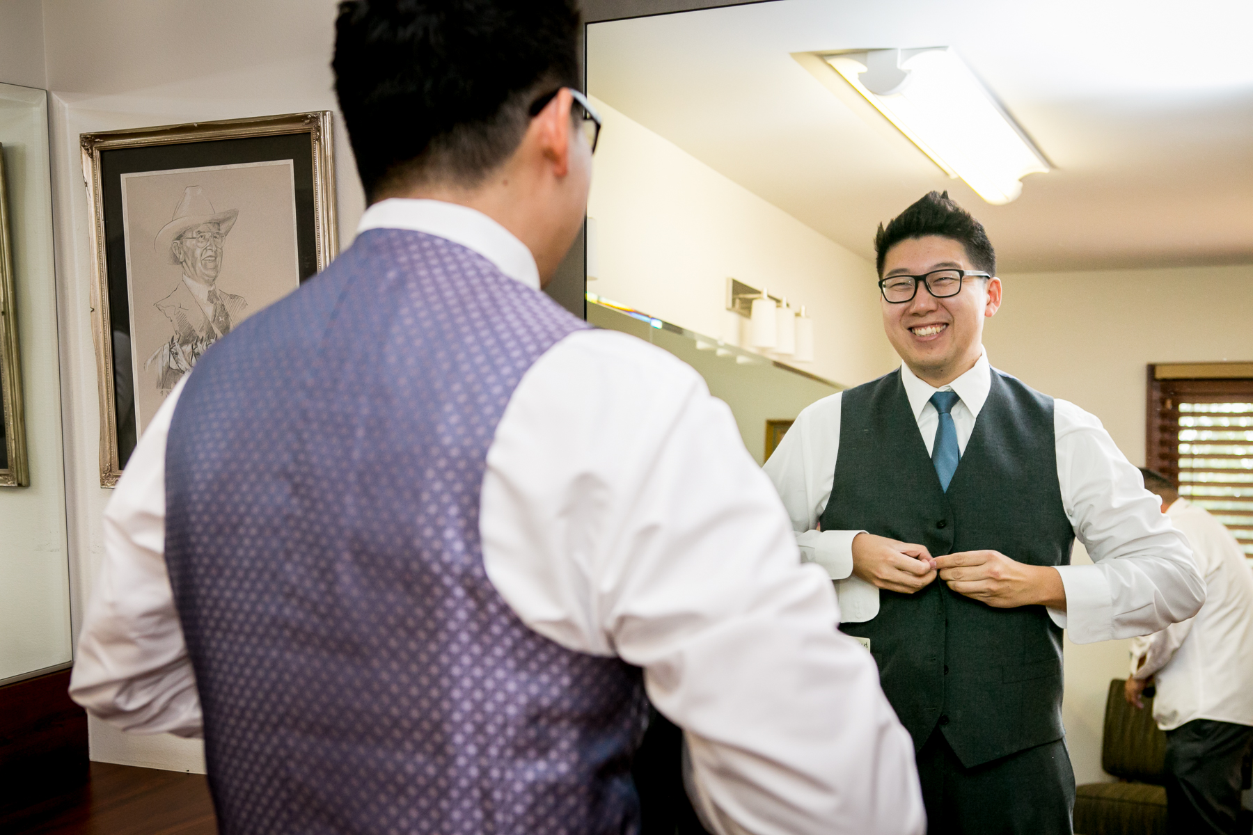 groom buttons vest jacket at getting ready at mccoy chino hills photographer