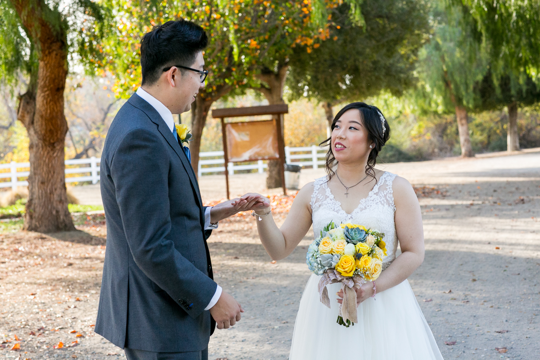 bride and groom see each other during first look at wedding at chino hills photographer
