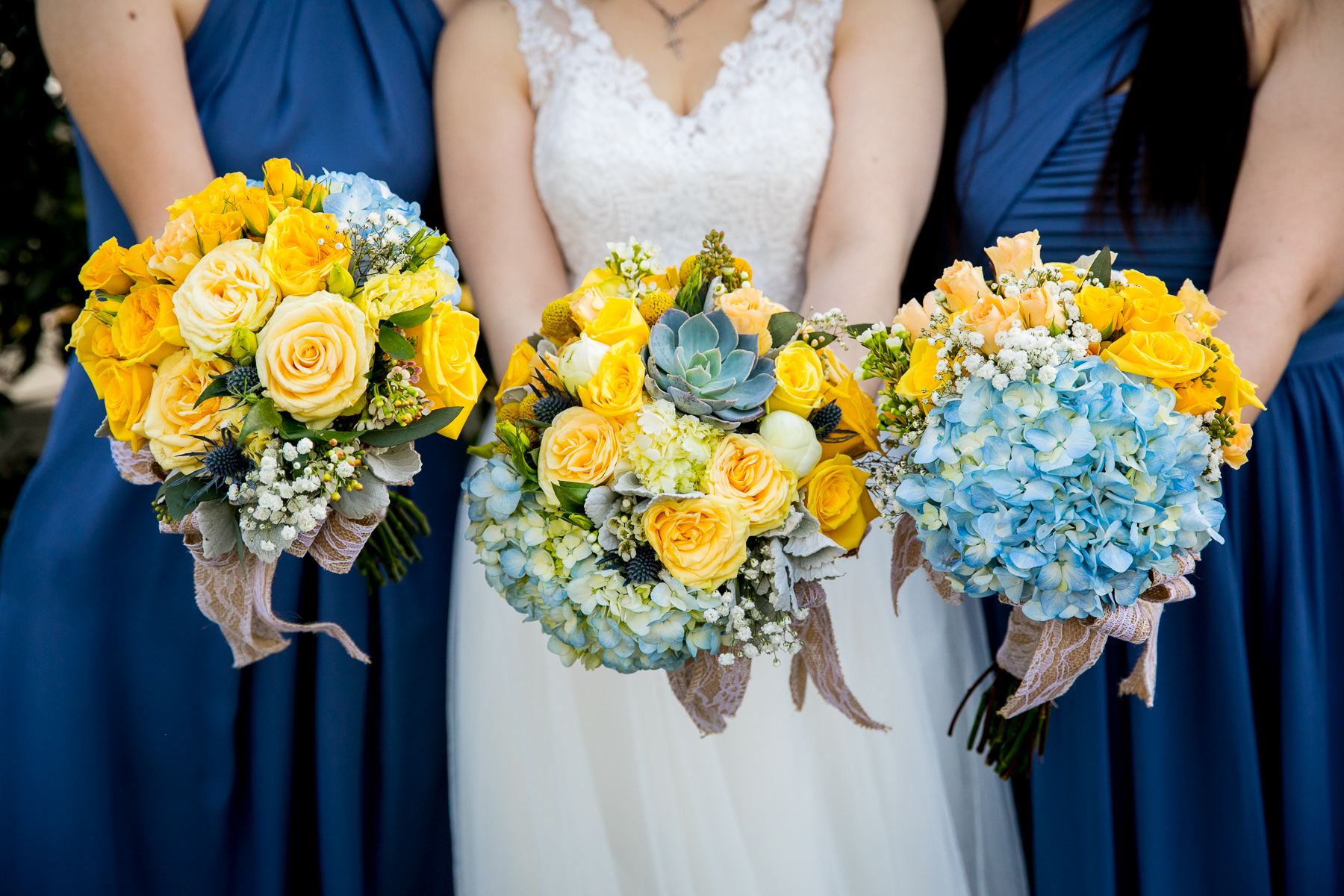 close up of yellow and blue bridal bouquets at chino wedding photography