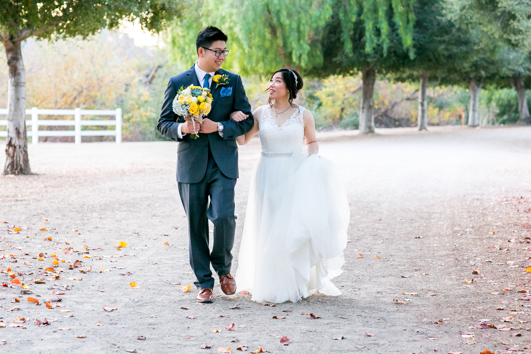 bride and groom walking photo at mccoy equestrian center in chino hills photos