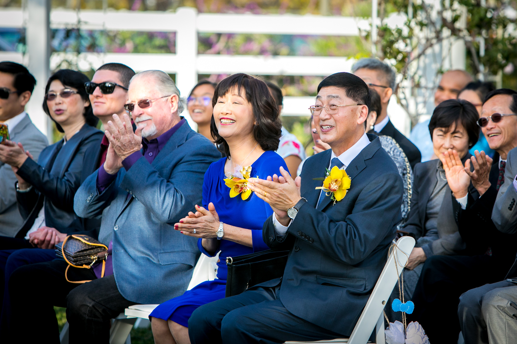 groom's parents clap during ceremony at chino hills wedding photos