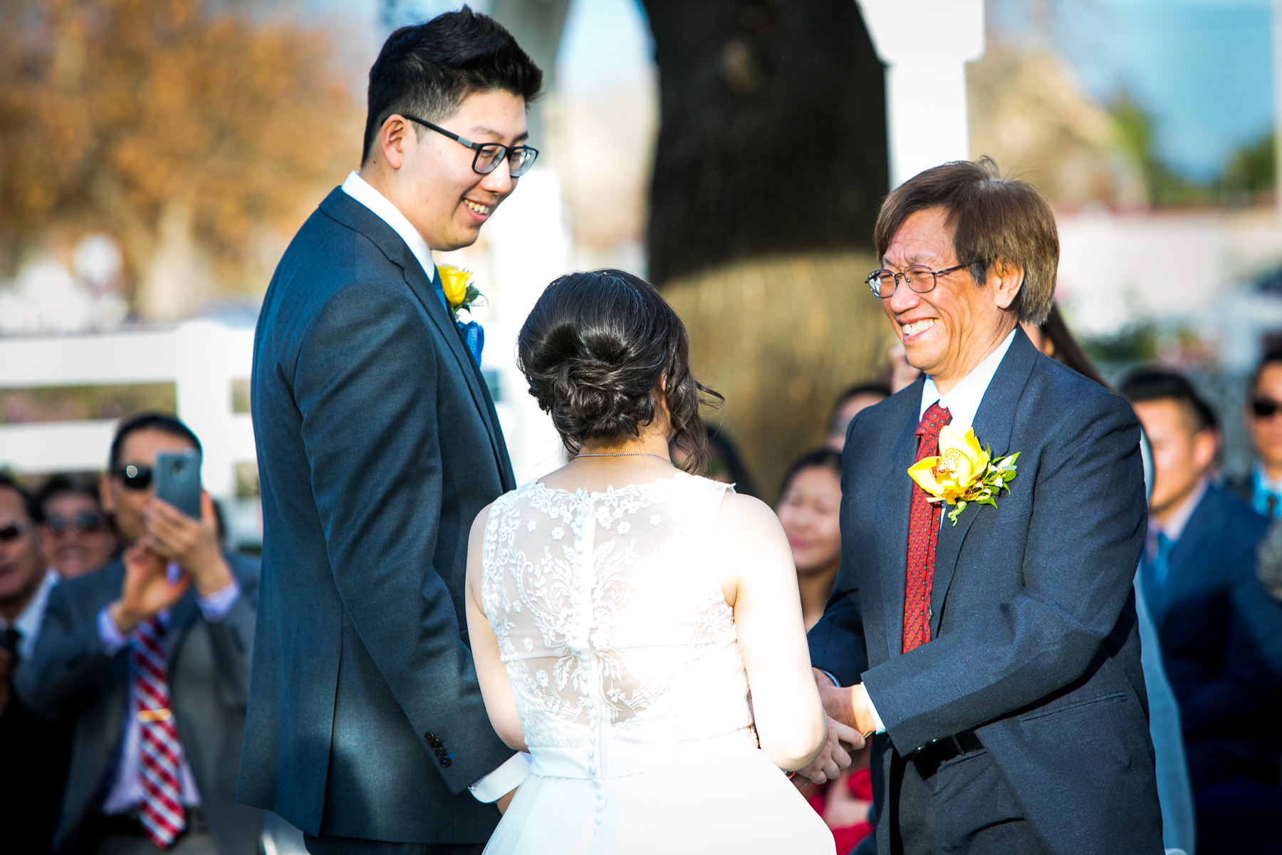 father of bride happy at wedding ceremony at chino photographer