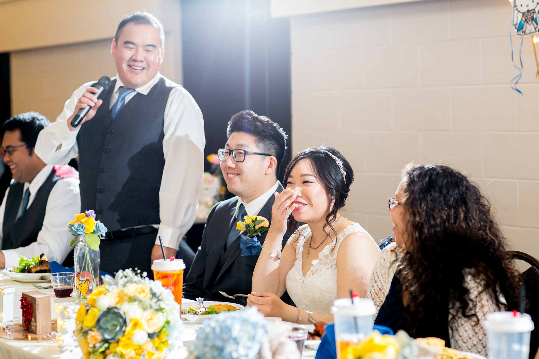 best man gets bride to laugh during speech at mccoy equestrian center wedding photos