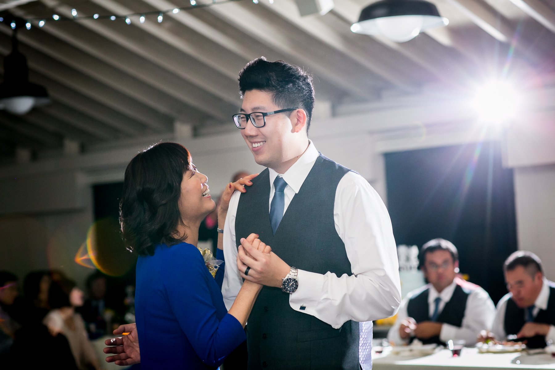 mother of groom looks up at son during mother son fance at reception of chino hills wedding photographer