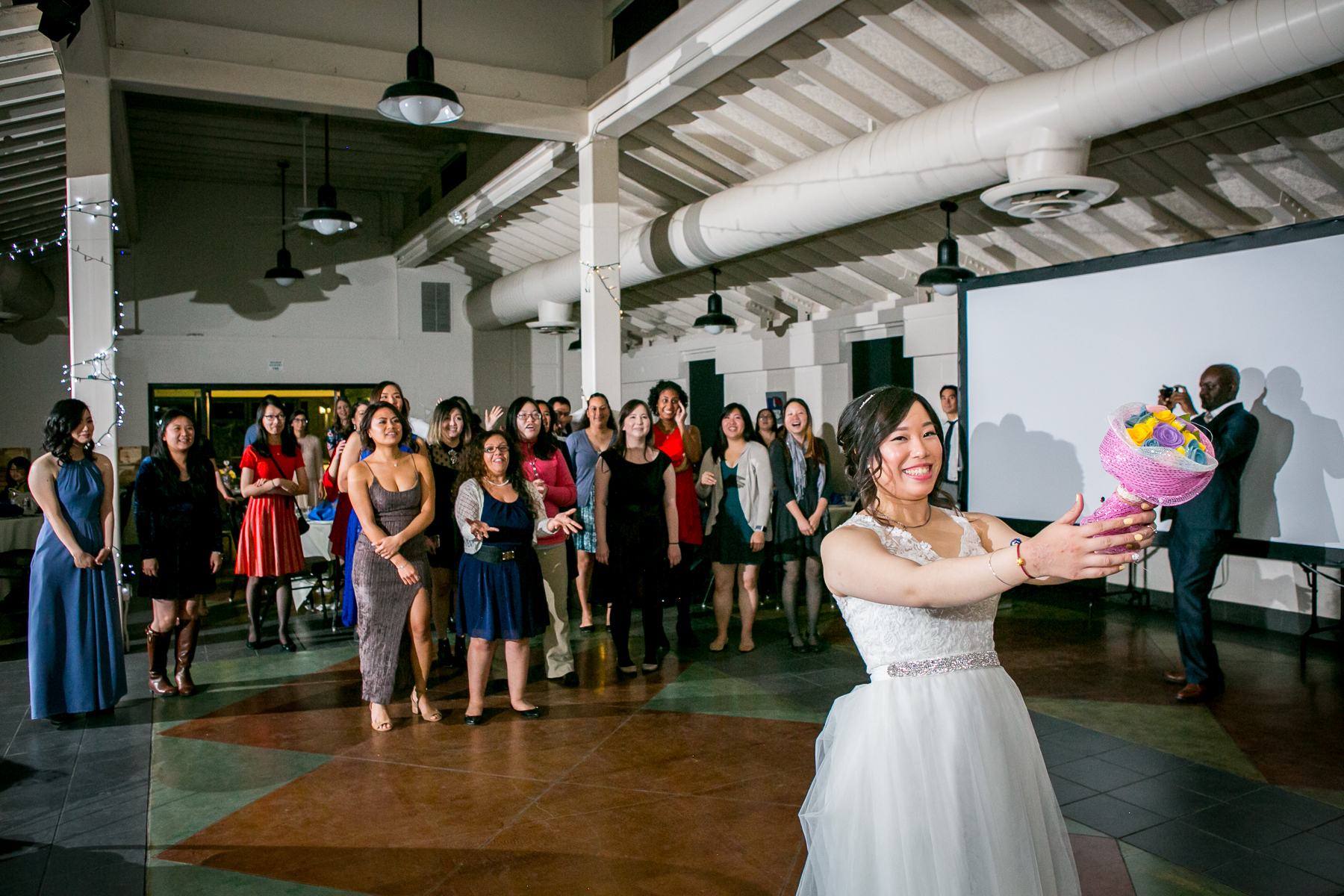 bride preps to toss the bridal bouquet at wedding at chino hills