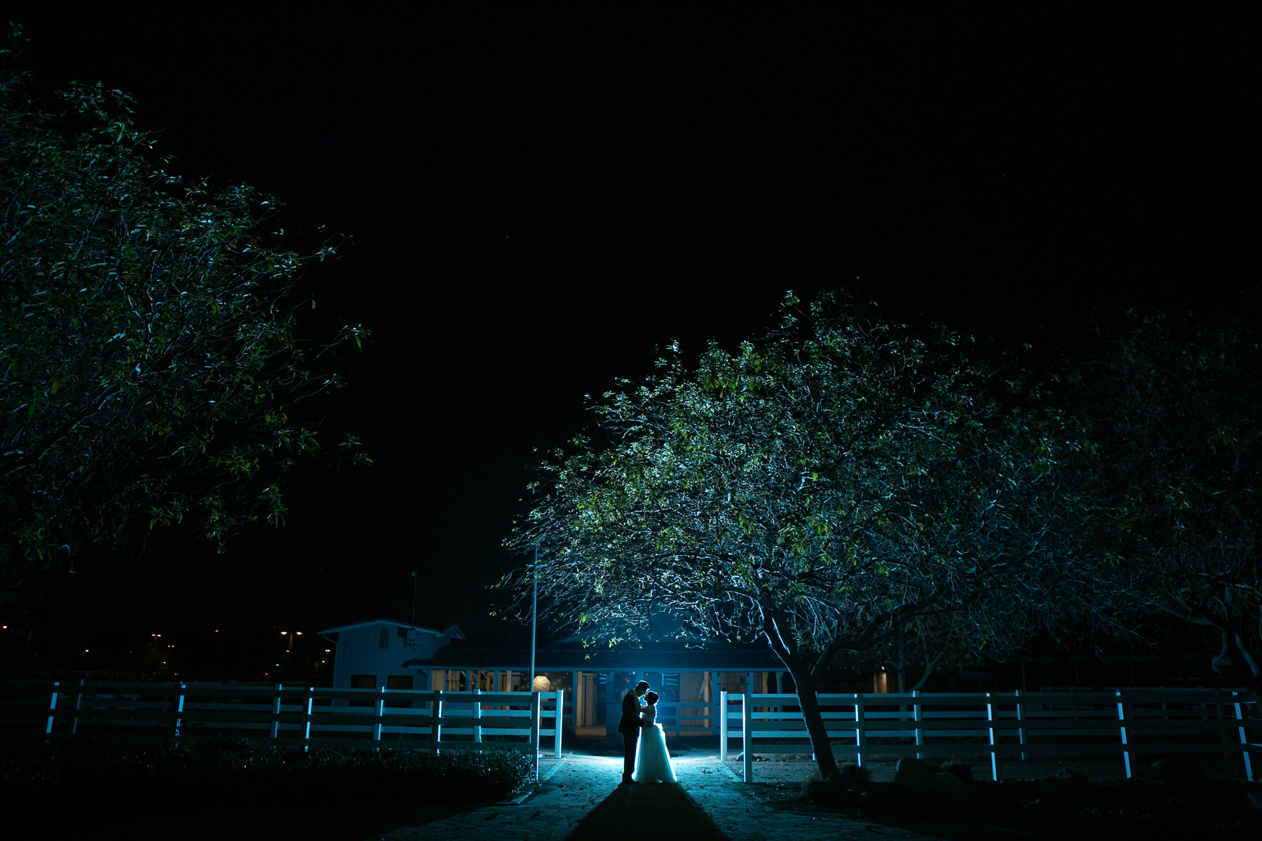 wide shot night portrait bride and groom at wedding at mccoy equestrian center