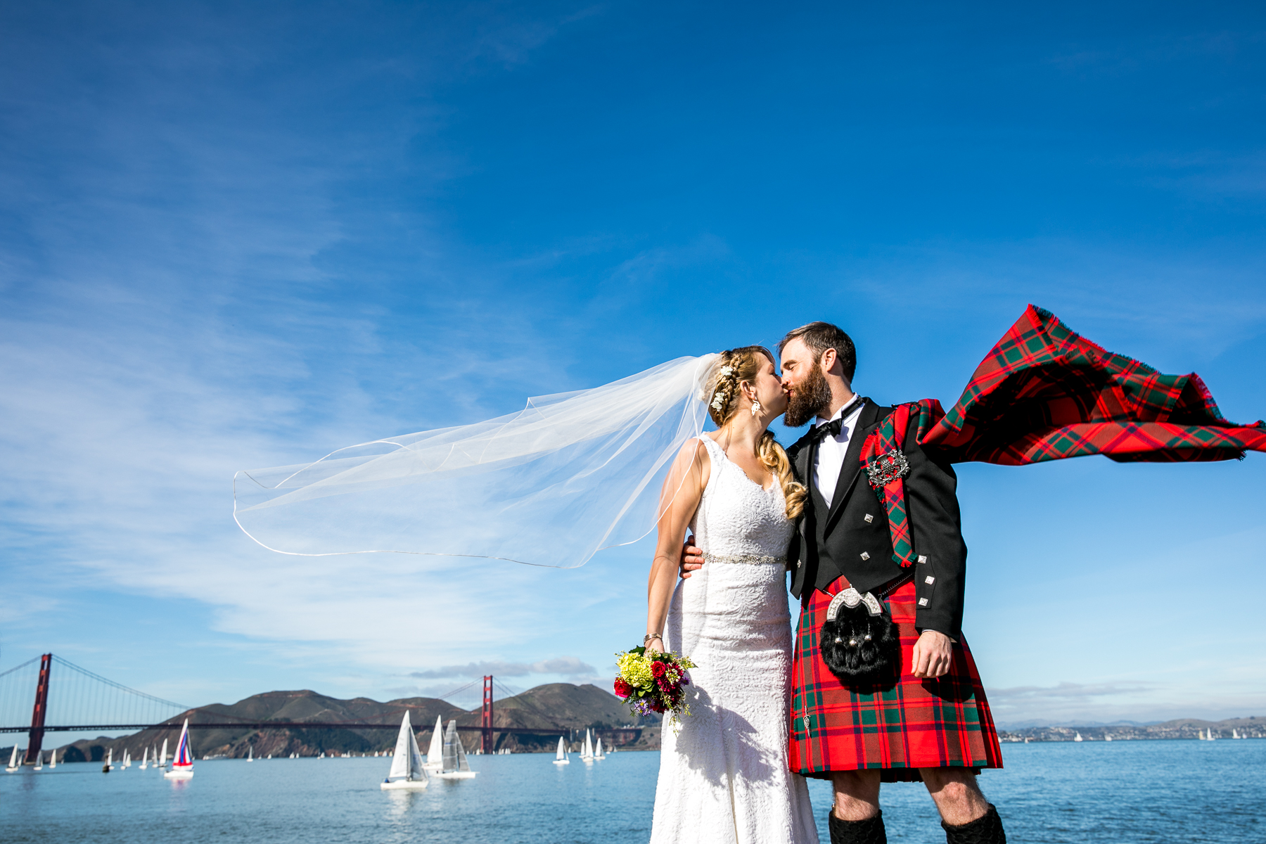 epic wind catches bride and groom veil scottish golden gate bridge san francisco wedding portrait