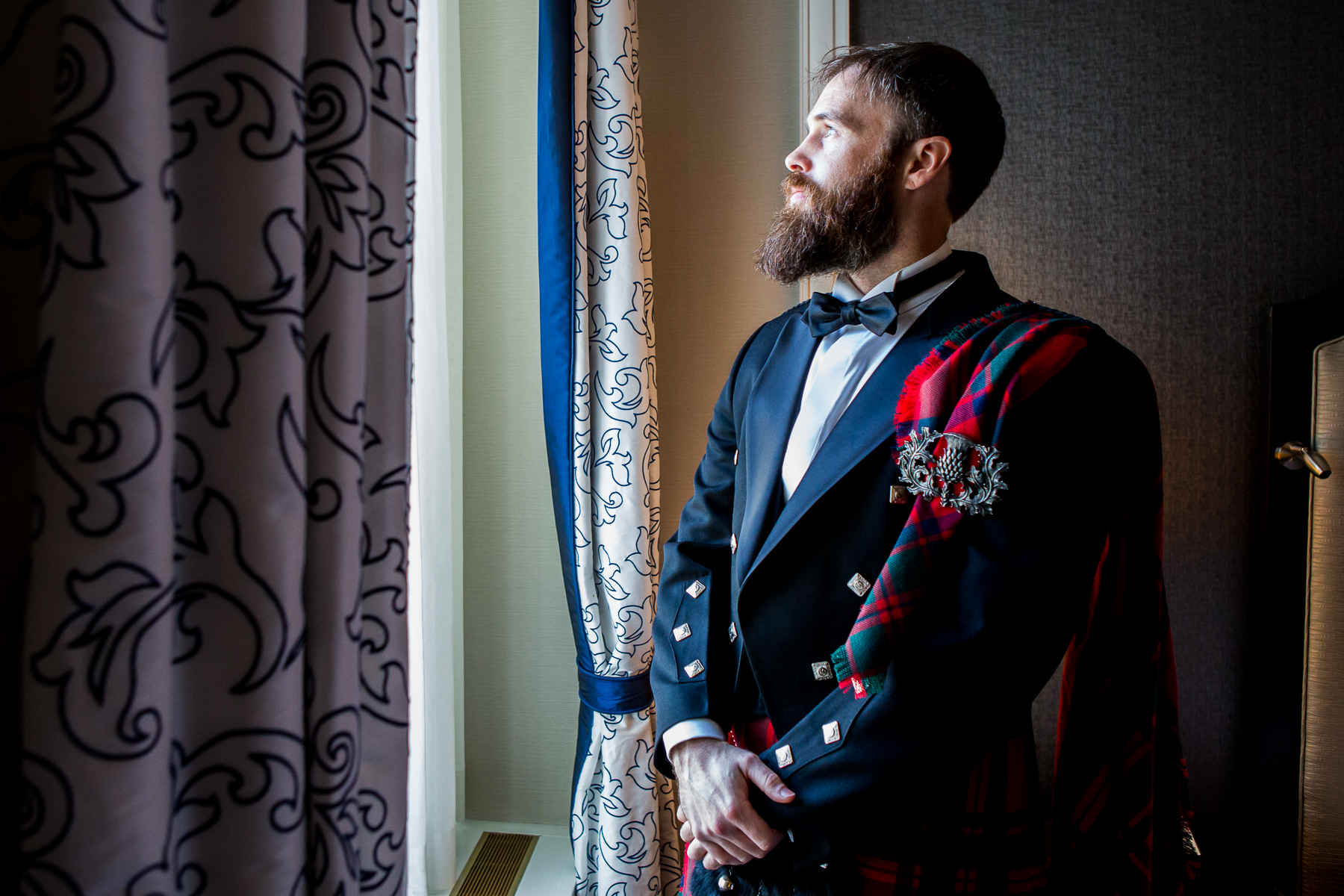 scottish groom looks out wedding on wedding in san francisco photographer