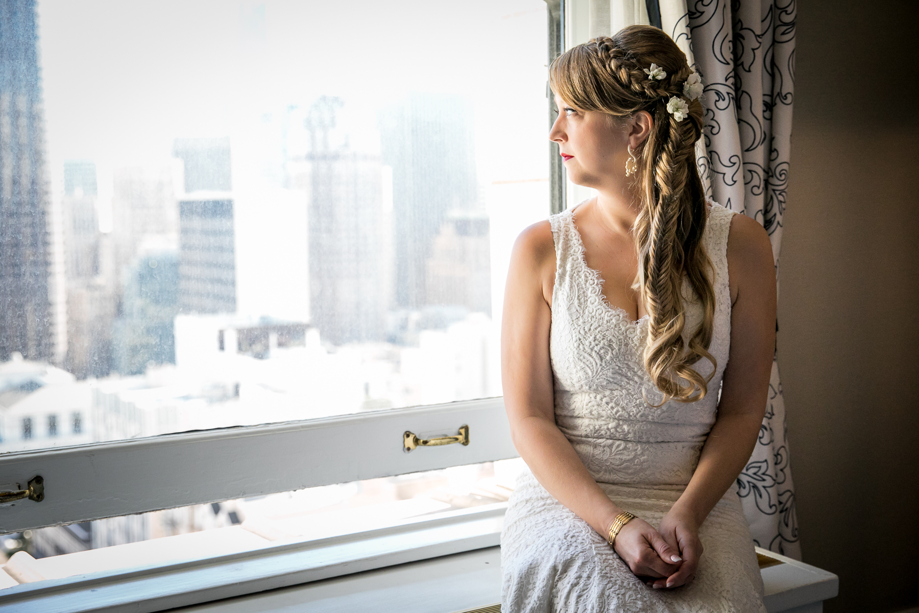 quiet moment for bride at window prior to first look at fairmont wedding photos