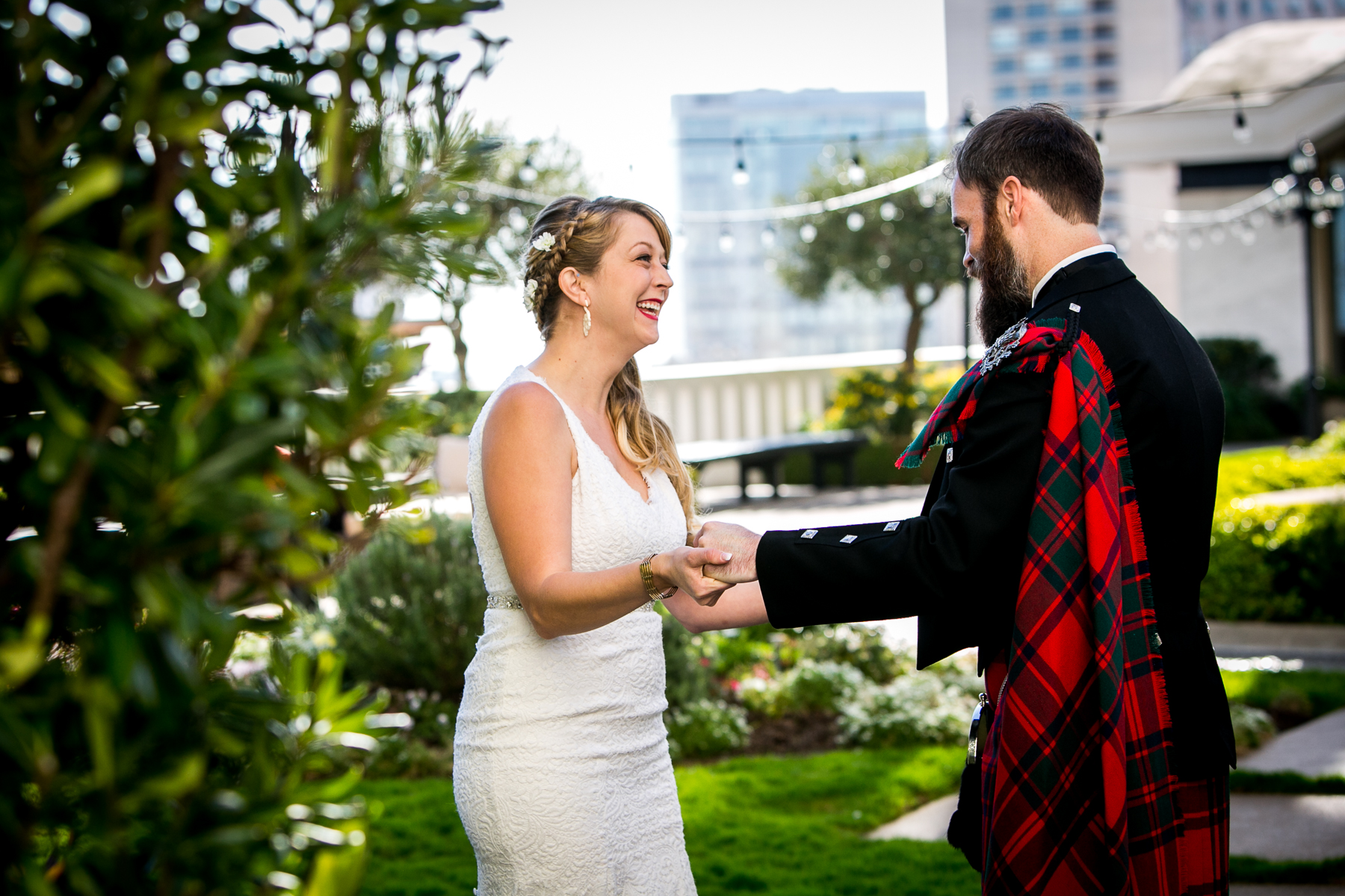 groom takes step back during first look at fairmont hotel wedding photographer