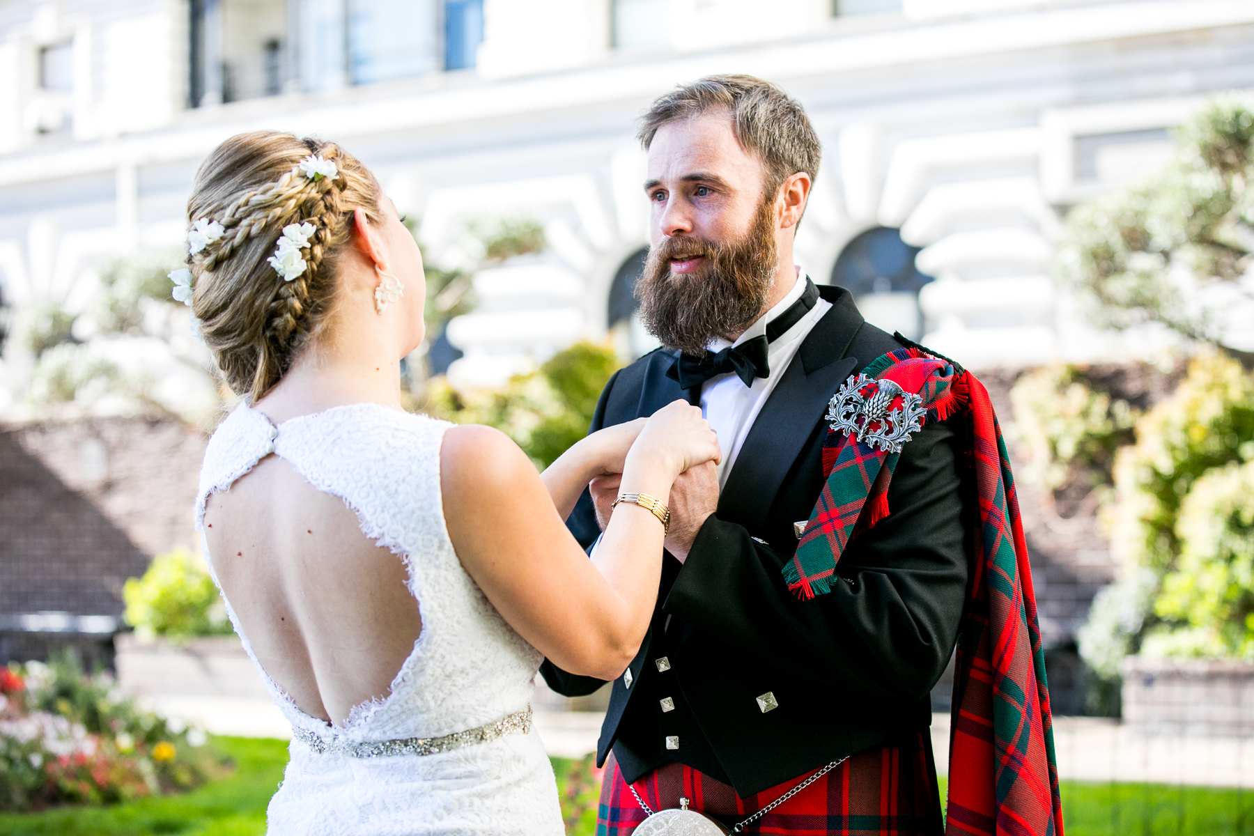 groom starts to get emotional during first look at fairmont hotel in san francisco wedding photographer