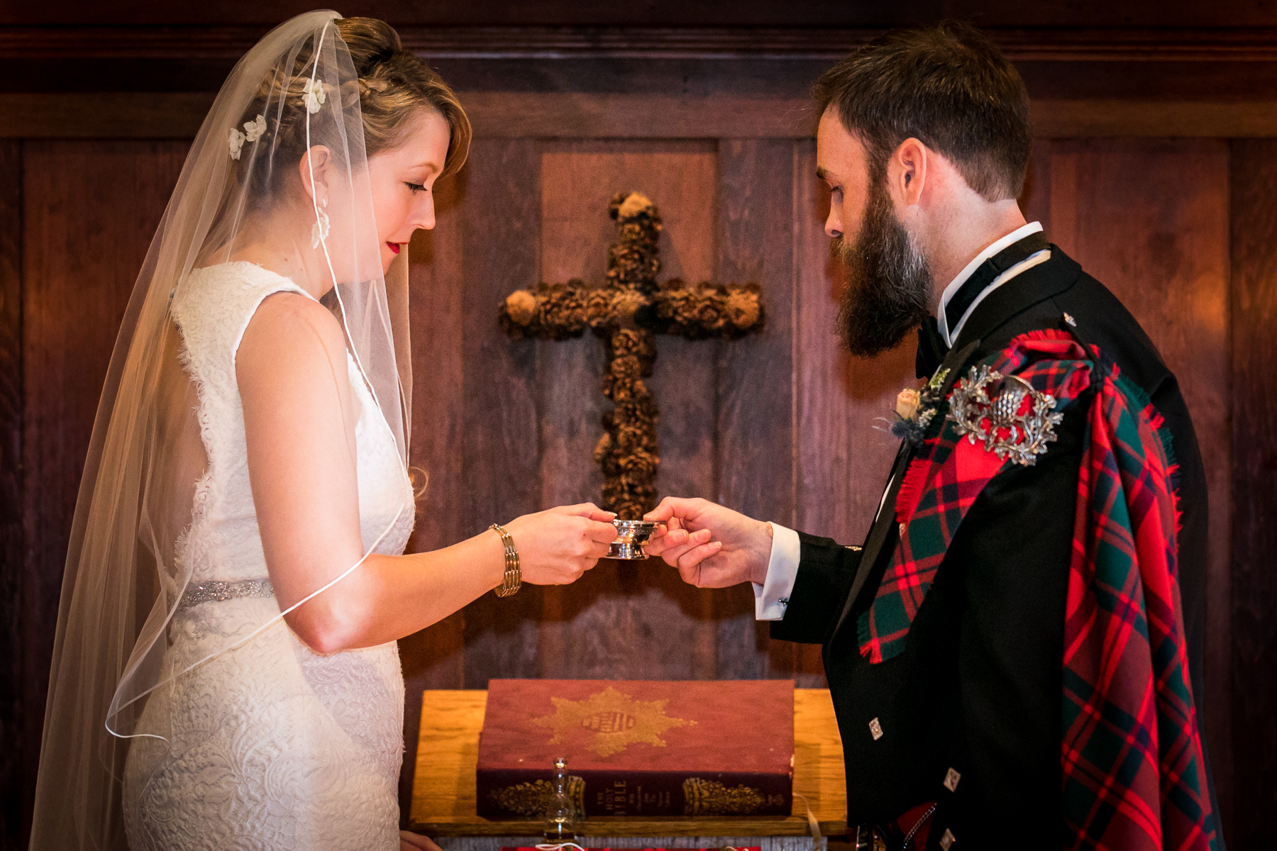 scottish bride and groom pick up quaich during wedding ceremony at swedenborgian church in san francisco photos