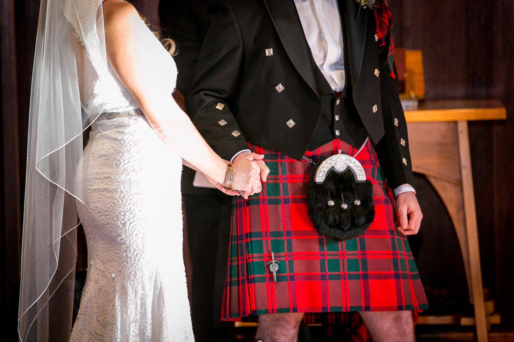 closeup of bride and groom wedding attire kilt during ceremony wedding at swedenborgian church photography