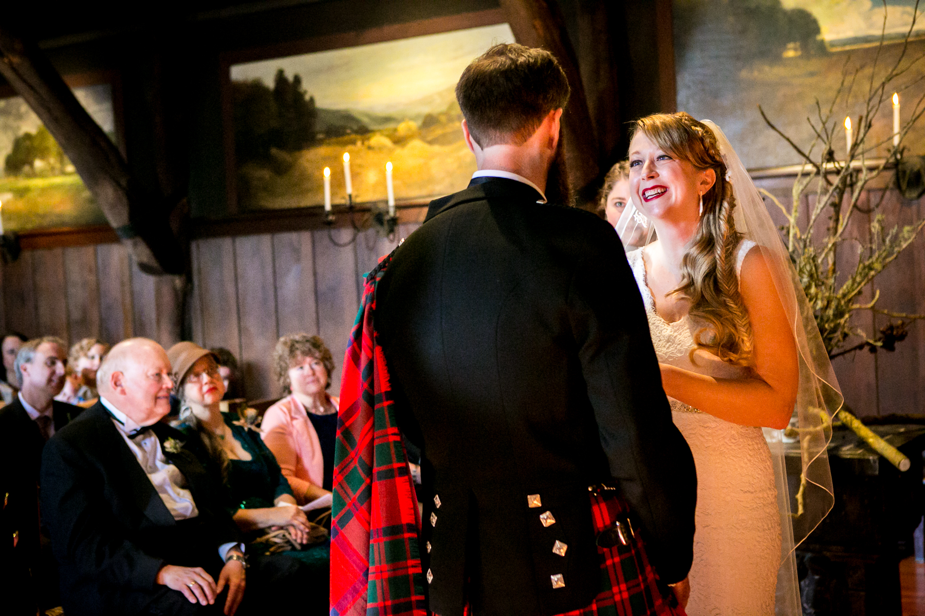 bride gives groom loving smile during vows at san francisco wedding at swedenborgian church photographer