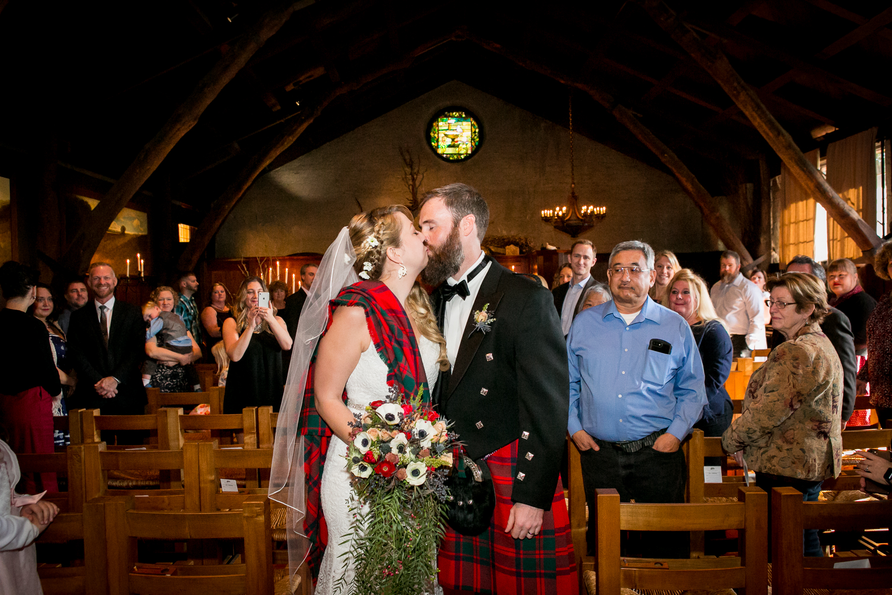 bride and groom kiss at end of wedding recessional at bay area wedding photos
