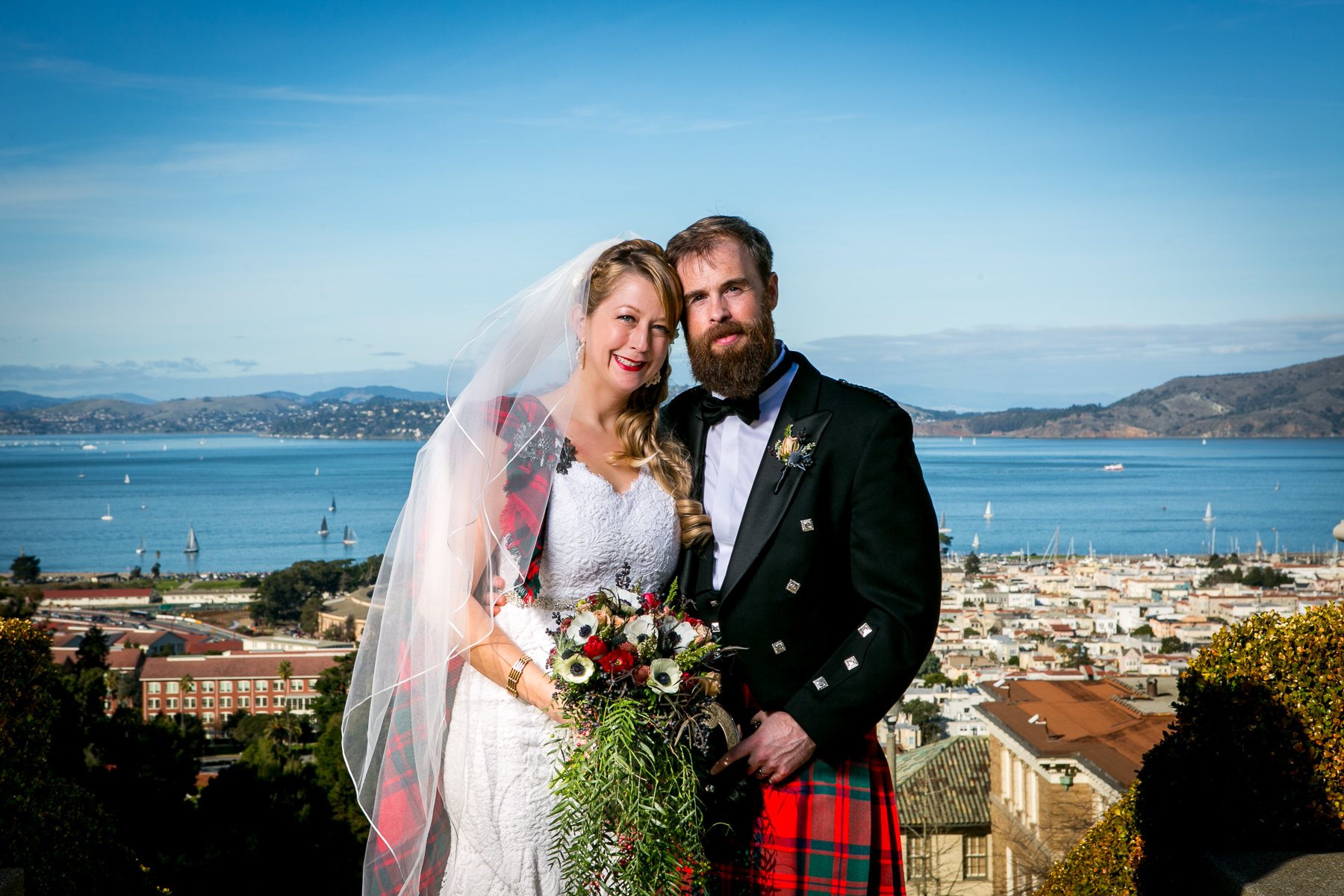 standard bride and groom portrait with view of bay wedding photographer