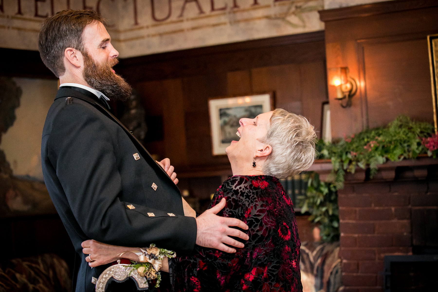 mother of groom and son have laugh during dance in san francisco swedenborgian church photographer